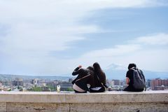 Three girls are sitting at the famous place Cascade in Yerevan, Armenia. Took from Cascade Yerevan. Three girls are enjoying the leisure time.The Cascade is a royalty free stock image