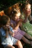 Three girls sitting outdoor stock photography