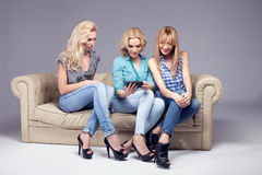 Three girls with smartphone. Royalty Free Stock Images