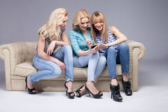 Three girls with smartphone. Stock Images