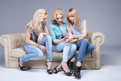 Three girls with smartphone. Royalty Free Stock Photos