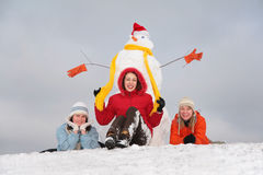 Three girls and snowman Royalty Free Stock Photo