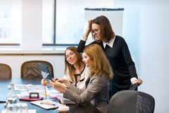 Three business girls decide problems on work Stock Images