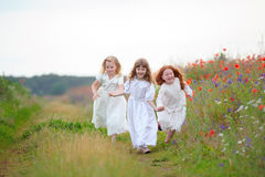 Three girls spending time together in the summer field Stock Image