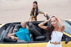 Three girls with sport car Royalty Free Stock Photos
