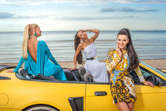 Three girls with sport car Royalty Free Stock Photo