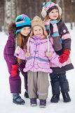 Three girls stand together in winter park Royalty Free Stock Photos