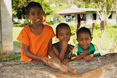 Three girls standing by the church, Navala village, Viti Levu, Fi Stock Photos