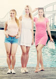 Three girls standing on waterfront royalty free stock images