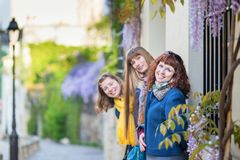 Three girls on a street of Montmartre Royalty Free Stock Photos