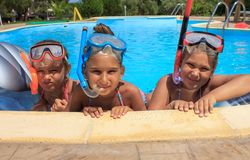 Three girls in the swimming pool. With diving mask Royalty Free Stock Photography