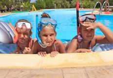 Three girls in the swimming pool Royalty Free Stock Images