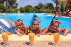 Three girls in the swimming pool Royalty Free Stock Photography