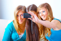 Three girls taking photos Royalty Free Stock Images