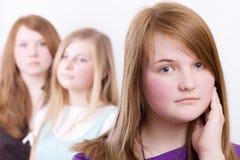 Three girls teenagers in crisis Stock Photos