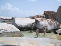 Three Girls in a Tide Pool. Teen girls standing in a tide pool nestled into gigantic granite boulders at The Baths at Virgin Gorda, British Virgin Islands. If royalty free stock image