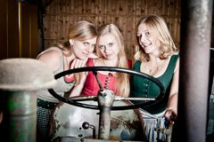Three Girls on a Tractor Stock Photos