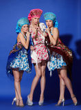 Three girls in traditional dress Royalty Free Stock Photography