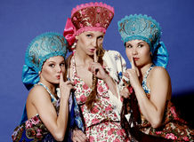 Three girls in traditional dress Stock Images