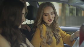 Three girls traveler driving a car in the car with a map stock video
