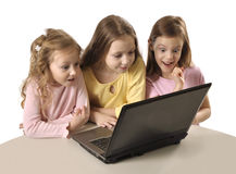 Three girls using laptop Stock Photography