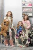 Three cute girls waiting for Christmas Stock Image