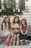 Three cute girls waiting for Christmas Stock Image