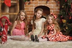 Three cute girls waiting for Christmas Stock Photos