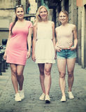 Three girls walking in city royalty free stock images