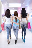 Three girls walking in the mall Royalty Free Stock Photo