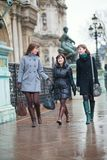 Three girls walking together in Paris Royalty Free Stock Image