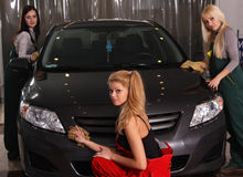 Three girls wash cars Royalty Free Stock Image