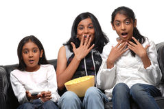 Three Girls watching TV. Three Girls are watching TV with fear Stock Image
