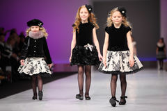 Three girls in wear from Snowimage on catwalk Royalty Free Stock Images