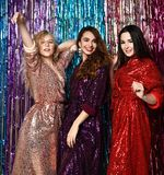 Crazy party time of three beautiful stylish women in elegant outfit celebrating new year, birthday , having fun, dancing royalty free stock images