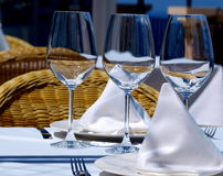 Three glases. Three new glases of wine on covered table Stock Photo
