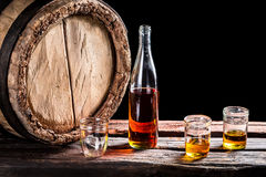 Three glass of aged whisky and bottle Royalty Free Stock Photo