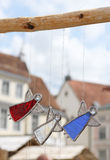 Three glass angels. On the background of the medieval city, Tallinn, Estonia stock image