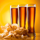 Three glass of beer and potato chips Royalty Free Stock Photos