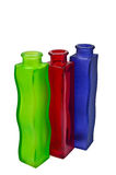 Three glass bottles. Three decorative glass colorful bottles on white background Royalty Free Stock Images
