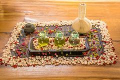 Three glass bottles with aromatic essence and spice on the wooden table Royalty Free Stock Image