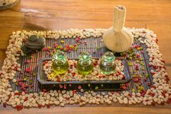 Three glass bottles with aromatic oils and spice on the wooden table Stock Photography