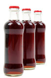 Three glass bottles with cola Royalty Free Stock Image