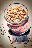 Three Glass Bowls Filled With Pinto, Red, Black Beans Stock Photo