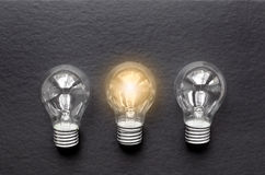 Three glass bulbs for lamps - idea concept Royalty Free Stock Photos