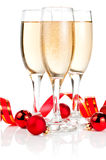 Three Glass of Champagne, Red ribbon and Balls Stock Photo