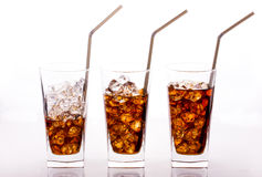 Three glass of cola with straws Royalty Free Stock Photos