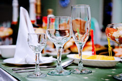 Three glass cups for drinking. Three glasses of alcohol to stand on the table stock photo