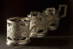 Three glass-holders Stock Photos