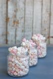 Three glass jars filled to brim marshmallow. Three glass jars filled to the brim marshmallow stock photo